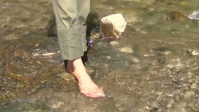 Man legs in the water stock video