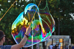 Man let a big bubble in the street Royalty Free Stock Photography