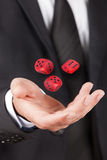 Man let float dice Stock Photography