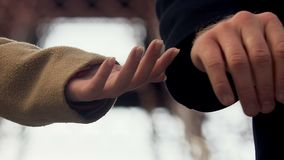 Man letting go woman hand and leaving, couple breaking up outdoor, unshared love