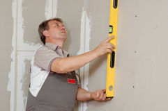 Man with level make renovation Royalty Free Stock Photo