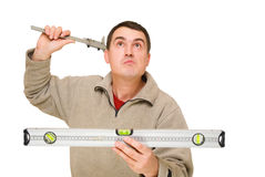 Man with level tool and trammel Stock Image