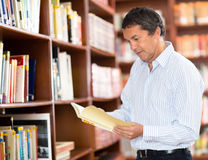 Man at the library Royalty Free Stock Photos