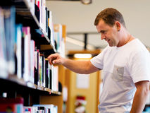 Man in library Stock Images