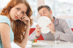 Man licking plate after finishing lunch. Stock Image