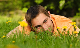 Man lie on the grass Stock Images