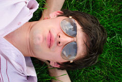 Man lie on the grass Royalty Free Stock Images
