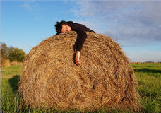 Man lie on the haystack Royalty Free Stock Photos