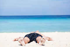 Man lies on a beach Royalty Free Stock Photo