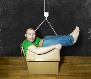 A man lies in a close box on the background of the drawing with Royalty Free Stock Images