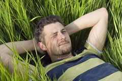 The man lies on a grass Royalty Free Stock Photos