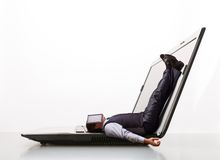 Man lies on laptop Stock Photos