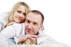 Man lies and woman lies on his back Royalty Free Stock Image