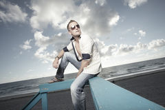 Man on a lifeguard tower on the beach Stock Image
