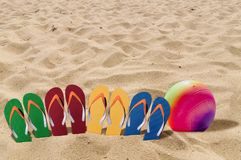 Man lifestyle four relax flip flops on orange beach sand and vol Royalty Free Stock Image