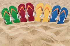 Man lifestyle four relax flip flops on orange sandy beach Stock Photos