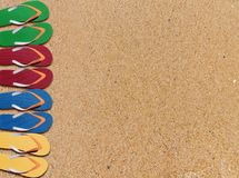Man lifestyle four relax flip flops on sandy orange beach backgr Royalty Free Stock Photos