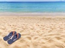 Man lifestyle relax flip flops on sandy beach with sea backgroun. Man lifestyle relax flip flops on sandy beach with sea Royalty Free Stock Photography