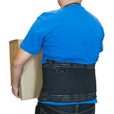 Man lift heavy carton wearing support belt for protect back Royalty Free Stock Image