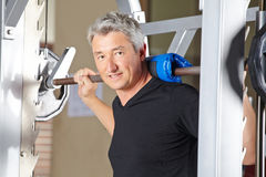 Man lifting barbell in fitness Stock Image