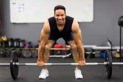 Man lifting barbell Stock Photos