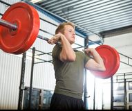 Man Lifting Barbell At Gym Stock Photos