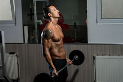 Man Lifting Barbell In Gym Stock Photo