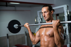 Man Lifting Barbell In Gym Royalty Free Stock Photos