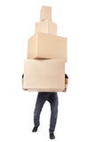 Man lifting cardboard boxes Stock Images