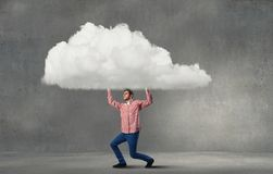 Man lifting cloud Royalty Free Stock Photos