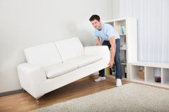 Man Lifting Couch Royalty Free Stock Photos