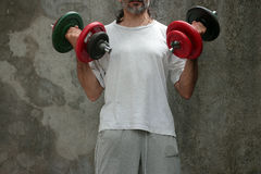 Man lifting dumbbell Stock Image