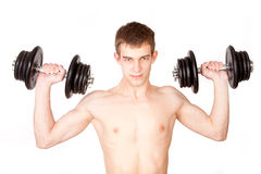 Man lifting dumbbell against black background Stock Photography