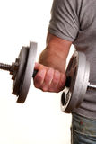 Man lifting dumbell. Weights over white background. Fitness shot Stock Images