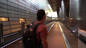 Man lifting on escalator at airport terminal, passenger looking around excited, travel concept, inspirational people. Man lifting on escalator at airport stock footage