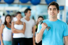 Man lifting free weights Royalty Free Stock Photos