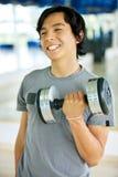 Man lifting free weights Stock Photos
