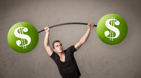 Man lifting green dollar sign weights Royalty Free Stock Photo