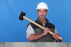 Man lifting hammer Stock Photos