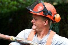 Man lifting Heavy log Royalty Free Stock Photo