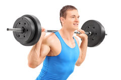 Man lifting a heavy weight. Isolated on white background Stock Images
