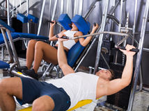 Man lifting heavy weights in press Royalty Free Stock Image