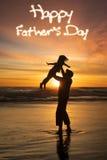 Man lifting his daughter at coast Royalty Free Stock Image