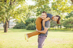 Man lifting his girlfriend Stock Photo
