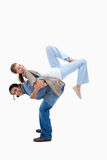 Man lifting his girlfriend on his back Royalty Free Stock Images