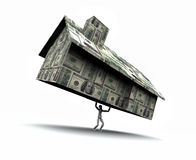 Man Lifting House Made of Cash Stock Photo