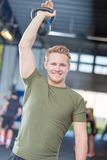 Man lifting kettlebell at crossfit center Stock Photo