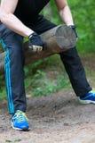 Man lifting log. Royalty Free Stock Image