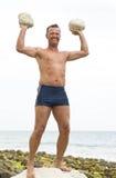 Man lifting rocks. Stock Image