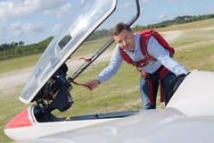 Man lifting roof sailplane. Man lifting roof of sailplane Stock Photos
